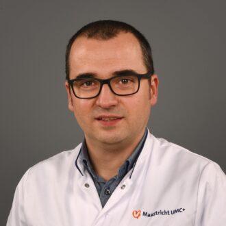 Dr. Razvan L. Miclea